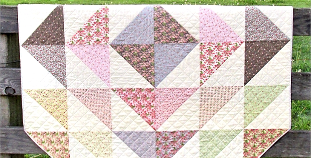big half square triangles make this quilt a breeze Cozy Half Square Triangle Quilt Patterns