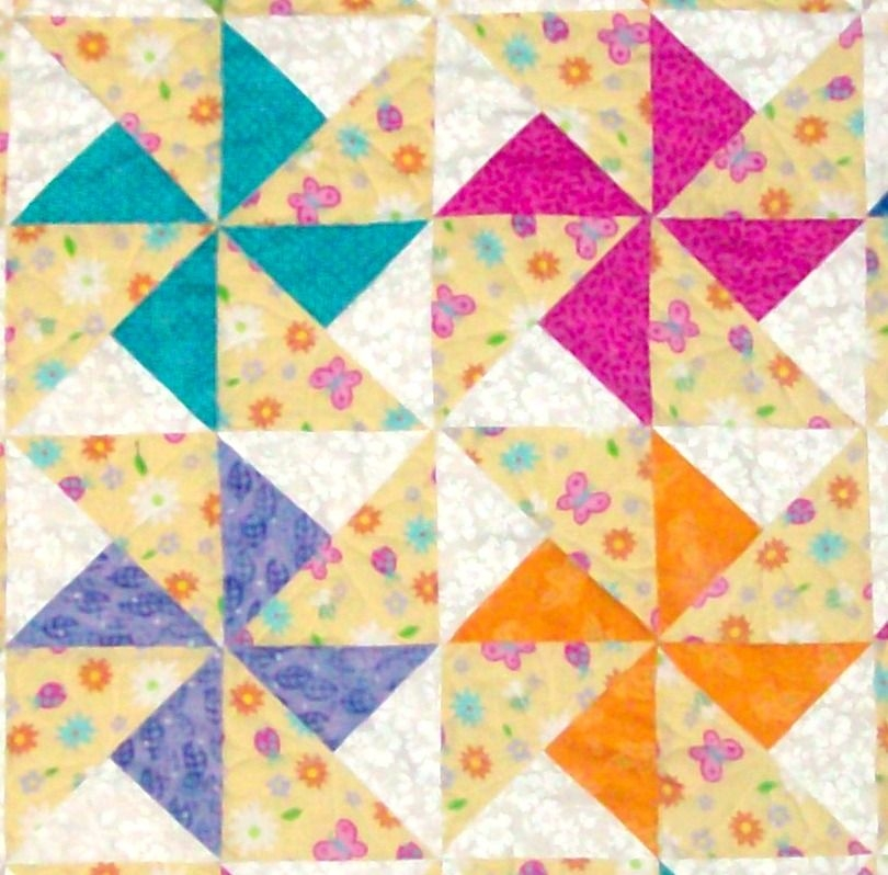 double pinwheel quilt block from my favorite quilt book Modern Double Pinwheel Quilt Pattern Inspirations