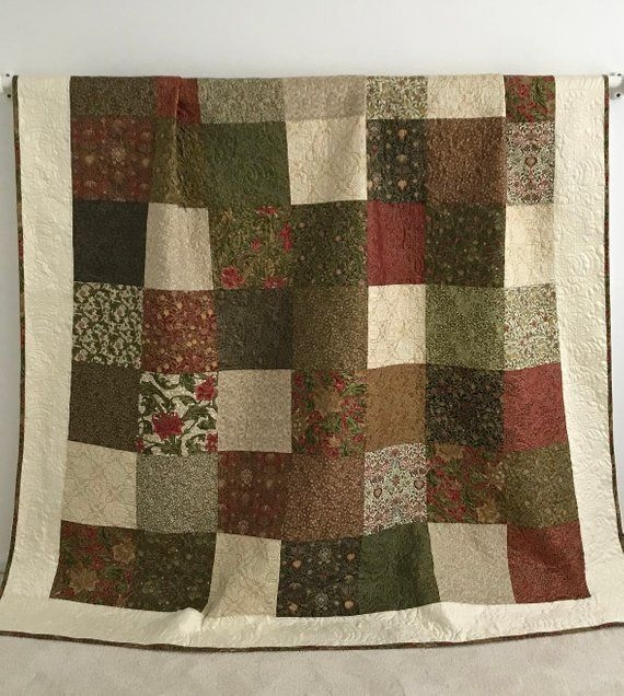 this modern patchwork quilt with holiday prints is made of Elegant Elegant Keepsake Quilting Fabric