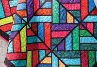 a stunning stained glass quilt using fabric strips Cool Stained Glass Quilt Pattern Inspirations