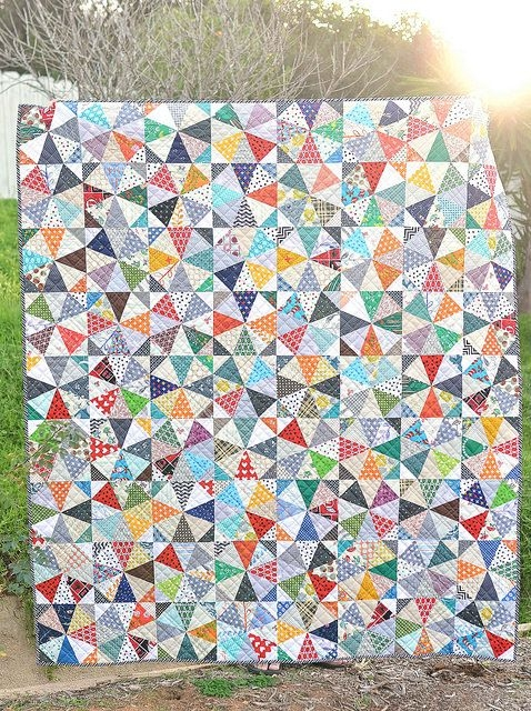finished scrappy kaleidoscope quilt with downloadable Cozy Kaleidoscope Patchwork Quilt Pattern