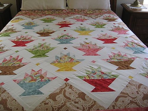 i love basket quilts and im going to make this some day Interesting Flower Basket Quilt Pattern