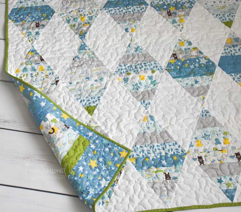 how to make a triangle quilt the seasoned homemaker Cool Quilts With Triangles