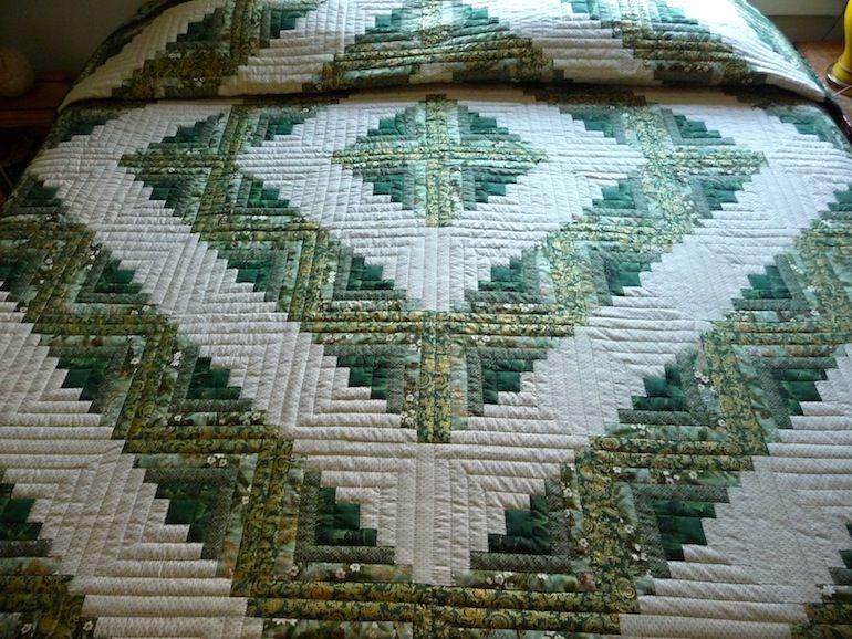 log cabin barn raising quilt made in various shades of green Cool Barn Raising Quilt Pattern Inspirations