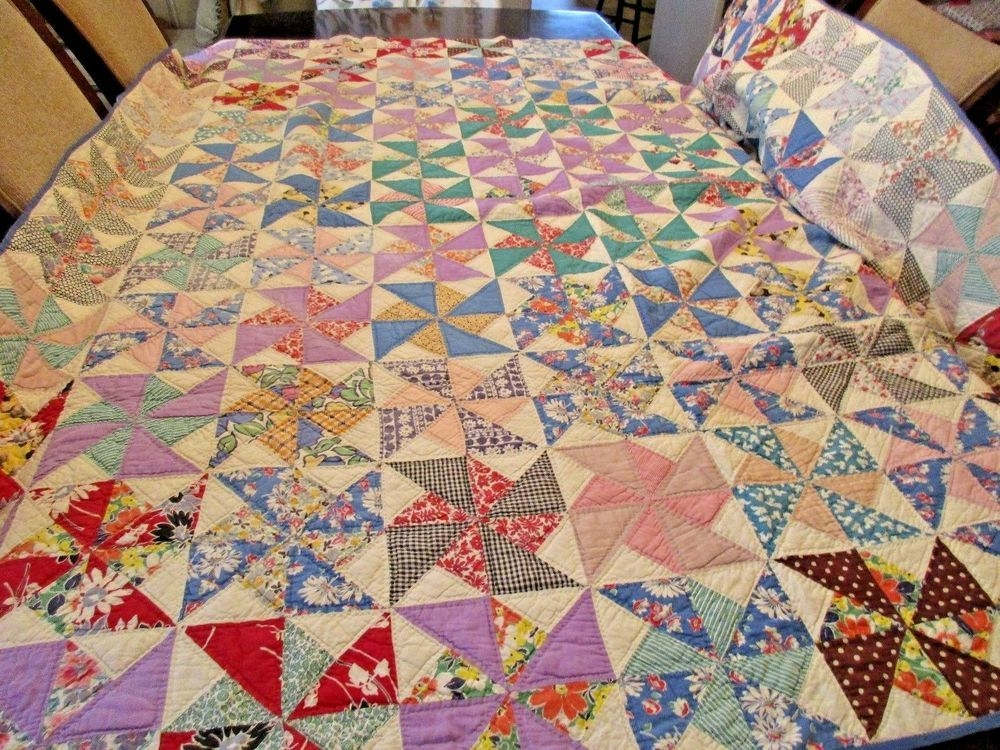 Beautiful vintage hand stitched quilt feedsack calico pinwheel blocks 9 Stylish Vintage Hand Stitched Quilts