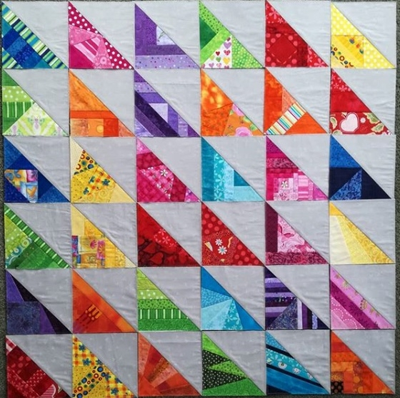 Cool 20 quilt ideas using half square scrappy triangles 10 Beautiful Half Triangle Quilt Inspirations