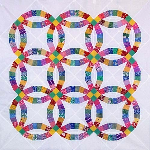 Cozy traditional double wedding ring paper pieced quilt pattern 9 Beautiful Traditional Quilt Patterns Inspirations