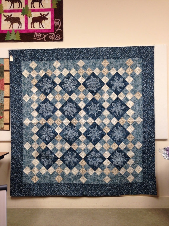 Modern beautiful finished snowflake quilt with fabrics and design Beautiful Lovely Laundry Basket Quilts Fabric Inspirations