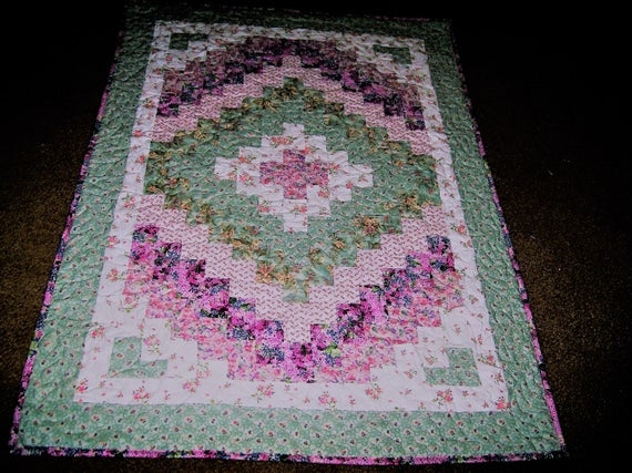 Stylish crib size quick trip around the world quilt in shades of pink and pastel green 9 Cool Quick Trip Around The World Quilt Pattern