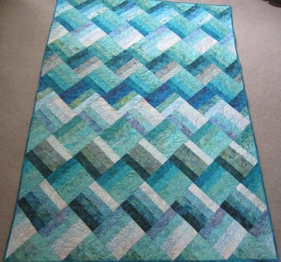 Beautiful pdf pattern ocean rail fence waves twin and queen sized quilt is easy and fun made from medium dark and light batiks in green blue purple 10 Elegant Ocean Waves Quilt Pattern Inspirations