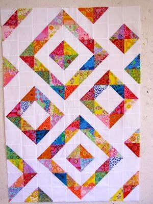 Cozy canton village quilt works it is a potpourri triangle Interesting Scrappy Half Square Triangle Quilt Patterns Gallery