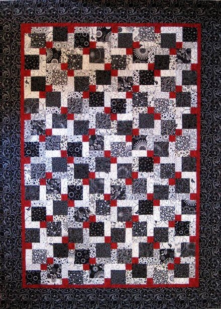 Cozy this is a black white and red disappearing 9 patch quilt i 11 Stylish Tossed Nine Patch Quilt Pattern Gallery