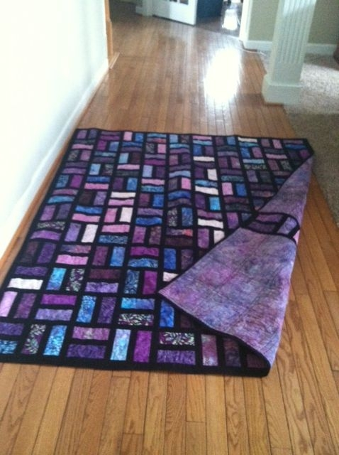 Interesting batik quilt uses 25x65 strips and 15 in sashing Batik Jelly Roll Quilt Patterns