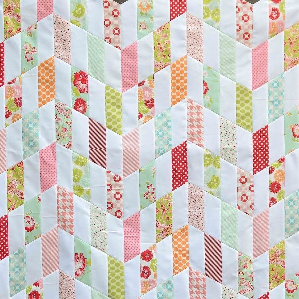 Modern cheverybodys favorite chevron quilt patterns favecrafts 9 Beautiful Chevron Stripe Quilt Pattern Gallery