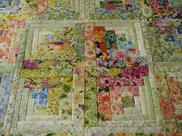 Unique okay heres what the 50 floral log cabin blocks turned into Elegant Floral Patchwork Quilt Patterns