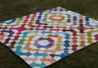 Beautiful exploding bowtie quilt layouts craftsy rainbow quilt 10 Elegant Bow Tie Quilt Pattern Layouts Gallery