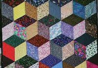 Cozy this interesting quilt is made with the tumbling blocks 10 Unique Building Block Quilt Pattern Inspirations