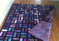Interesting batik quilt uses 25×65 strips and 15 in sashing Batik Jelly Roll Quilt Patterns