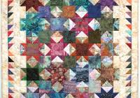 make striking borders with half square triangles quilting Elegant Half Square Triangle Quilt Borders