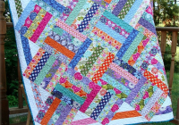 vivid prints shine in this easy quilt jelly roll quilt 11 New Jelly Roll Quilt Ideas Inspirations